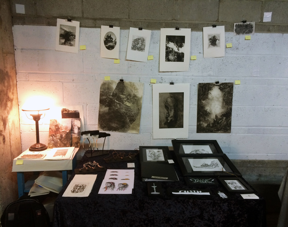 Kicking myself for not posting about it sooner, but I had a great time selling prints, originals, patches, and jewelery (along with  Myles Dunigan  [wall] and Paige Hinshaw of  Statuary Designs ) at Vacant Farm's Holiday Art & Craft Sale this weekend.  Thanks to all who came!  Vacant Farm is KC community art space facilitating and supporting all manner of artistic creation, education, and exhibition, located in an industrial patch in Westport.  I felt very welcomed by all the artists involved, and hope to see them again!  Check out all that VF has to offer here:  http://www.vacantfarmkc.com/