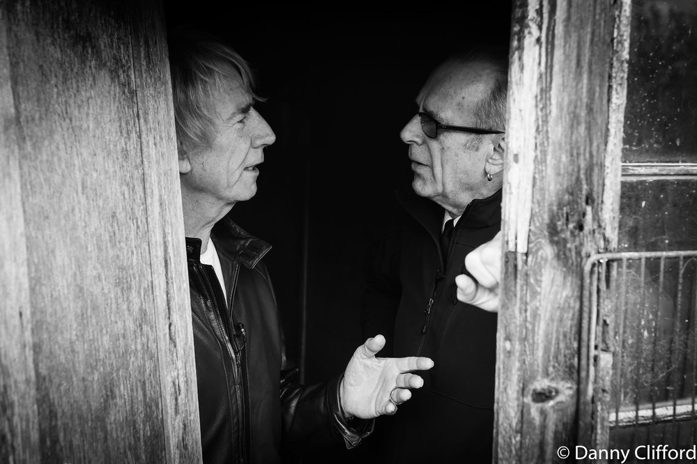 Rick & Francis in a shed on a farm. They were obviously discussing the best way to grow tomatoes!