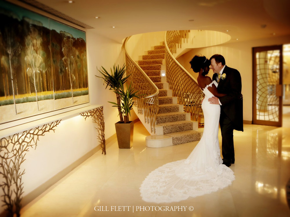 bride-groom-stairs-dorchester-ballroom-mature-interracial-wedding-gillflett-photo-london.jpg