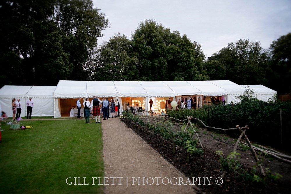 marquee-ham-house-dusk-exterior-wedding-gillflett-photo.jpg