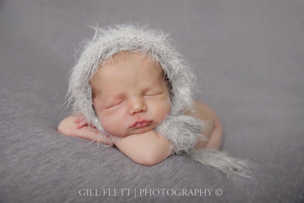 newborn-boy-grey-hat-side-pose-gillflett-london.jpg