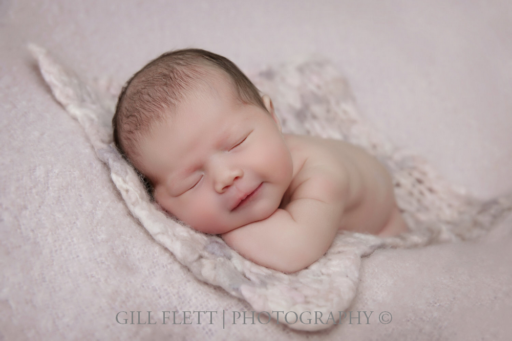 newborn-side-pose-smiling-gillflett-london.jpg