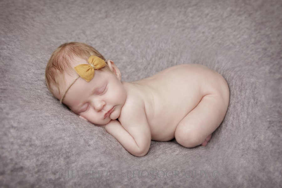 newborn-tushie-up-grey-background-yellow-tieback-gillflett-london.jpg