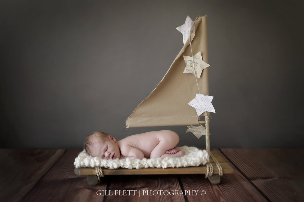 Surrey newborn photographer baby on a boat