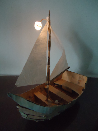 Boat made with cardboard box and battery-operated LED. Givatayim, 2012.