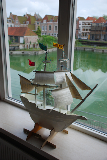Ship made with cardboard box, embroidery thread, and bookless pages. Middelburg, 2010.