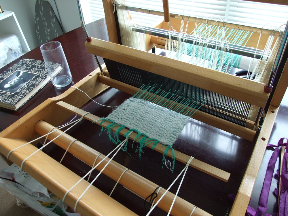 My first weaving on a loom! All out of mystery fibers from my stash.