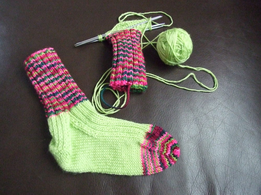 Toddler socks from scrap yarn.
