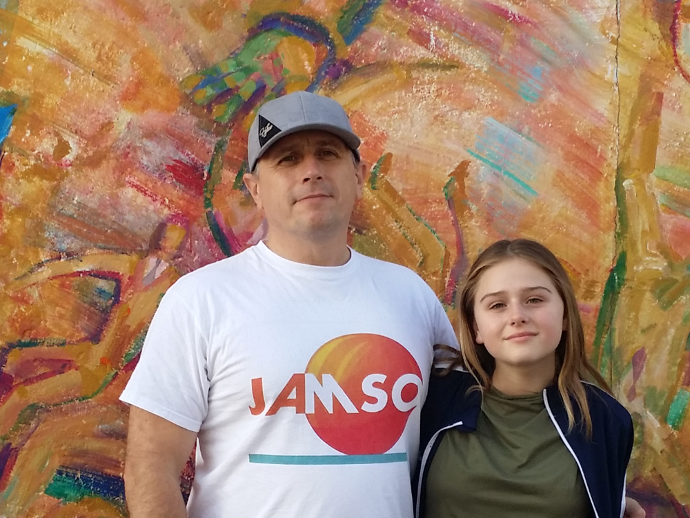 JAMSO founder James with his daughter at the Berlin wall - representing the colors