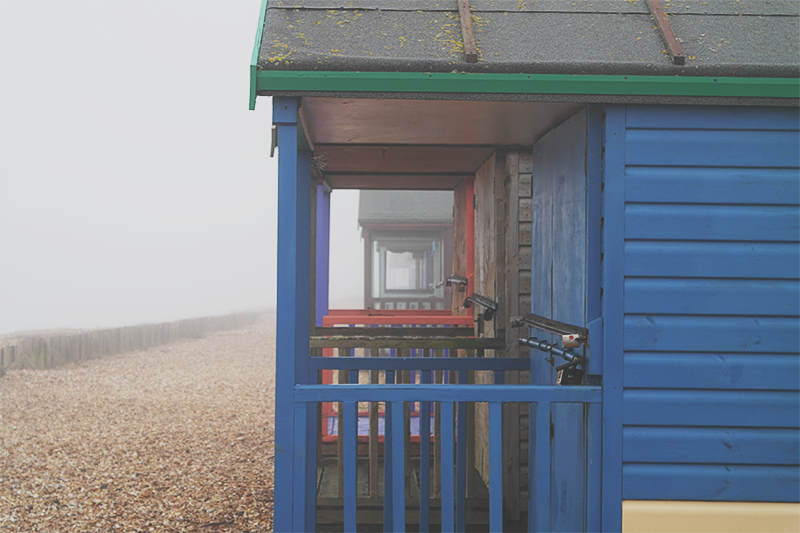 Beach huts on a Foggy day at Calshot Beach, the New Forest