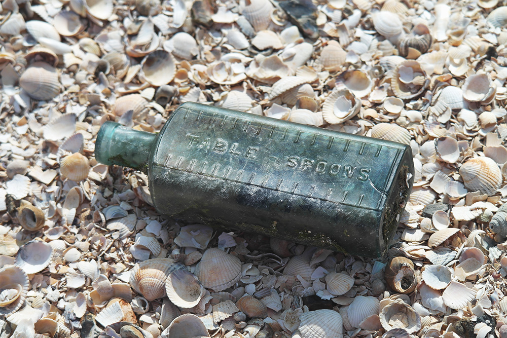 Washed up bottle on the beach