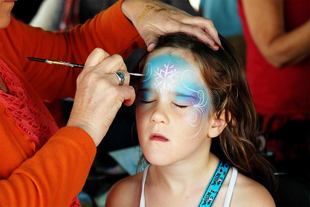 Kitty gets a Frozen Princess face painting at Camp Bestival 2014