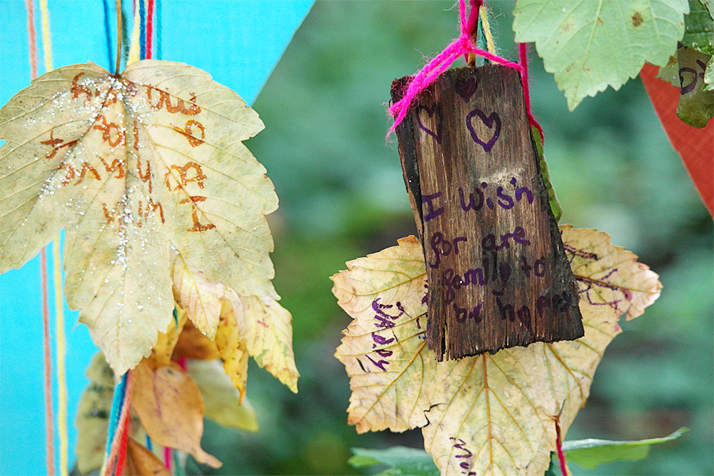 I loved this yarn message tree at Lizzie's Way, Camp Bestival - children wrote their wishes on leaves and bark to hang to display.