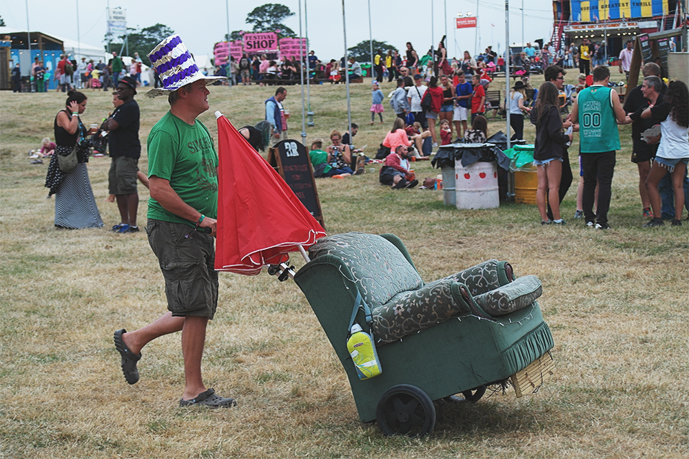 Man with armchair, Camp Bestival