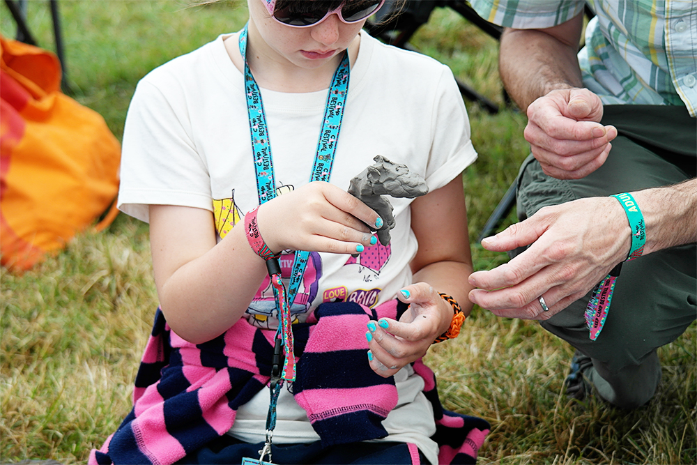 Children making clay animals at the Soul Park, Camp Bestival