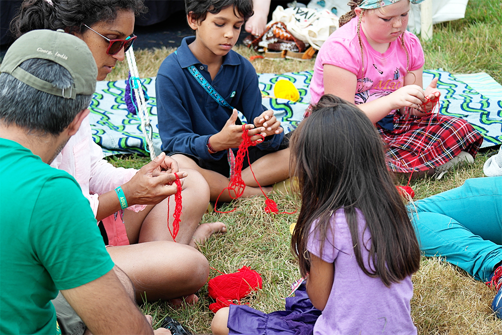 Learning to finger knit at Camp Bestival
