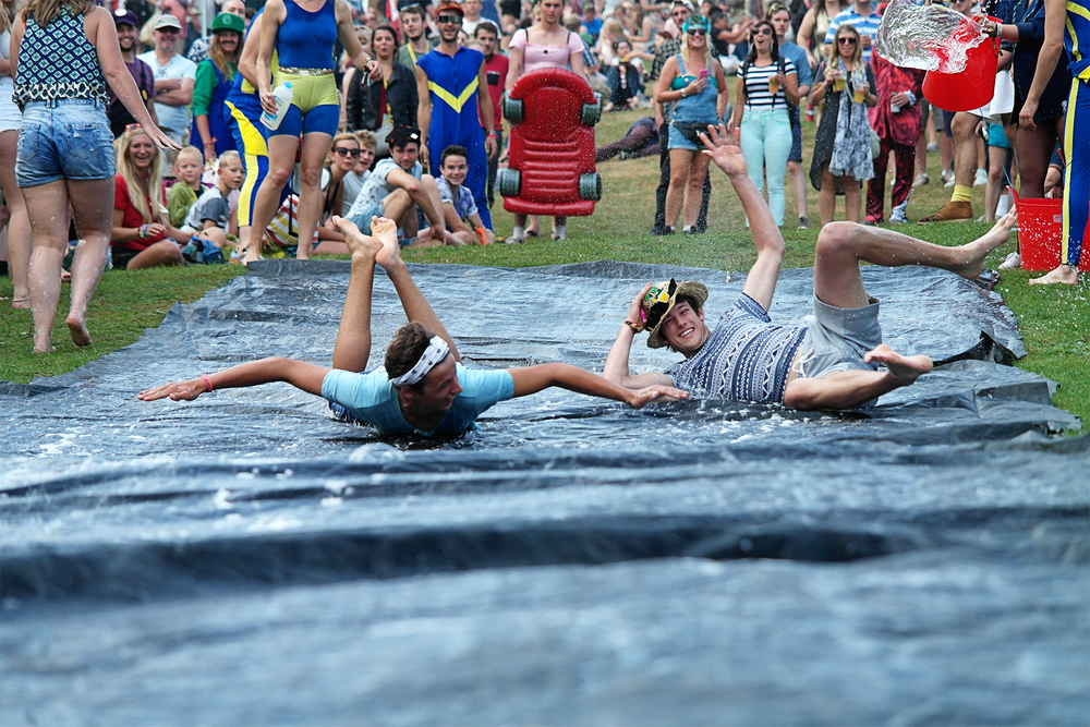 The Slippery Slip, water-sliding at Bestival 2014