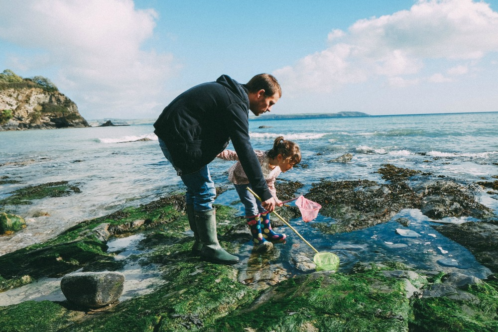 Exploring rockpools at Porthpean Beach, Cornwall