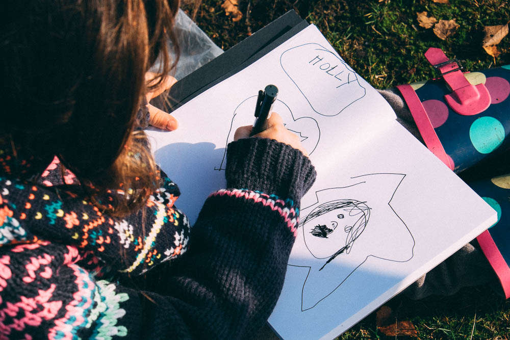 Kitty draws some holly that we spotted and that's me on the right apparently!