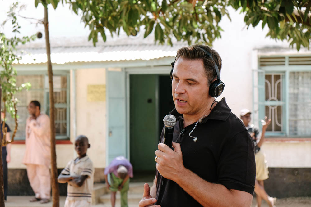 David Walliams in the middle of a live radio broadcast at HOVIC, Kisumu, Kenya