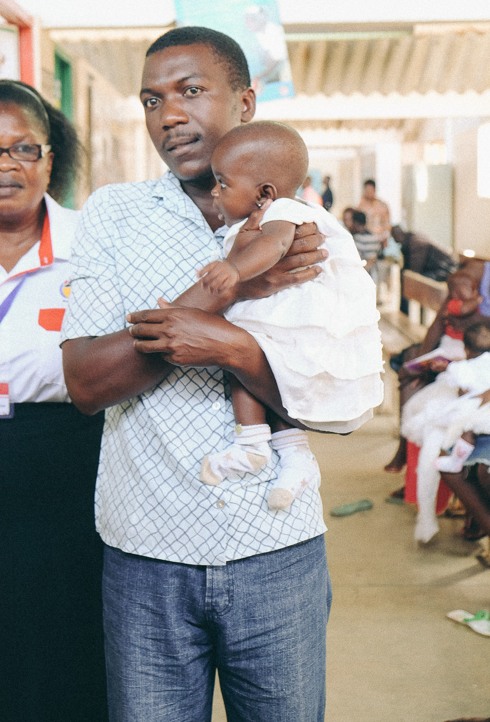 A father getting involved at the clinic at JoTRH, Kenya