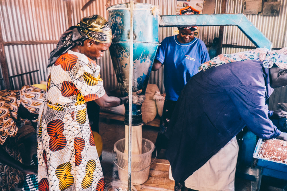 Milling flour with Rafiki Support Group, Kenya