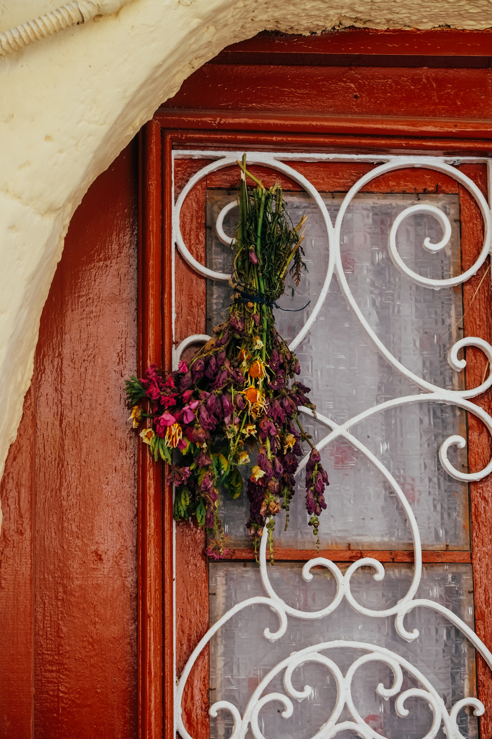 Flowers hung in doorway, Rhodes
