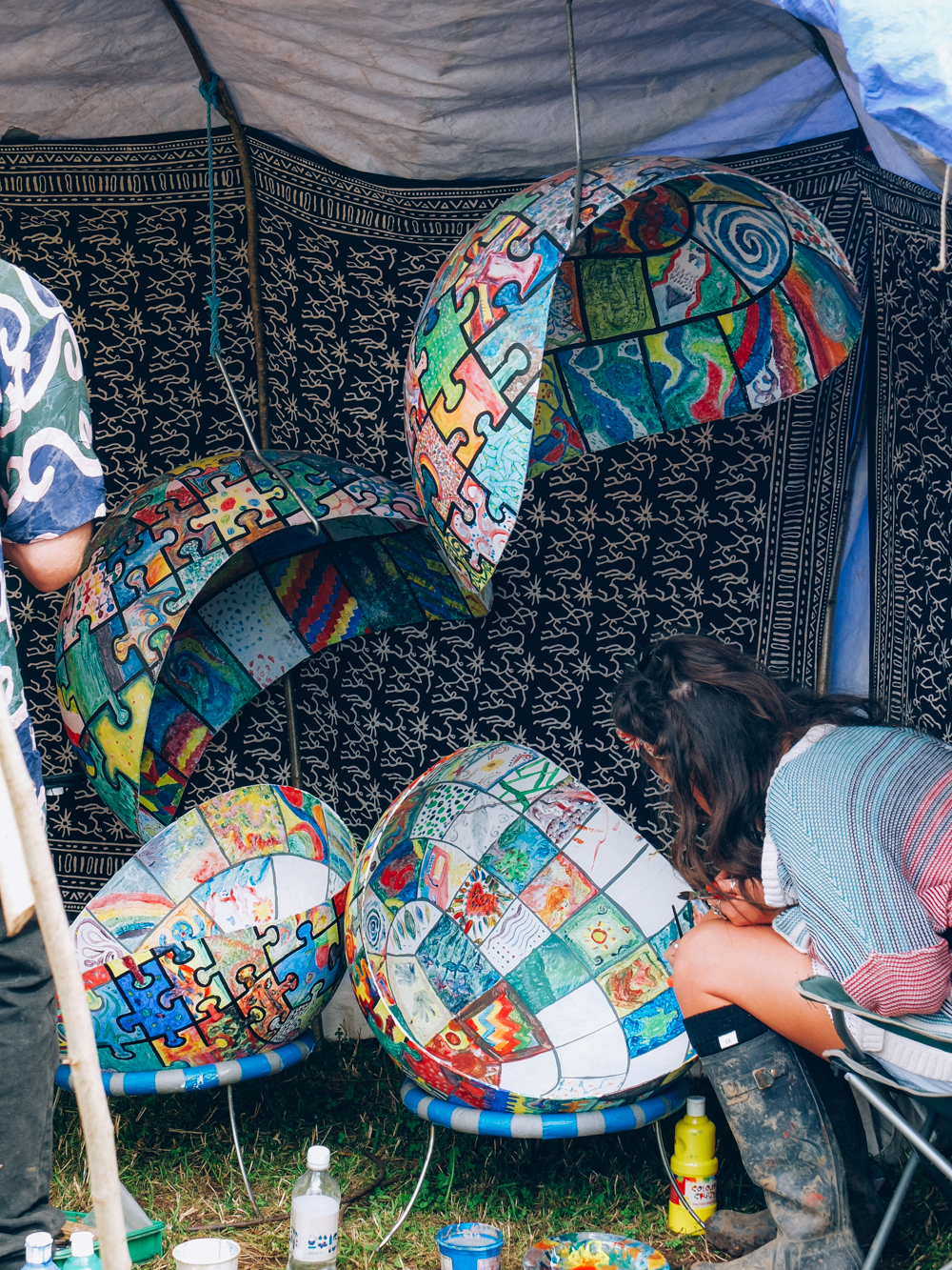 (Above) Photos of The Greencrafts Village, Glastonbury Festival 2015: A Drop of the Ocean , makes Porcelain bells using sgraffito with Glastonbury clay