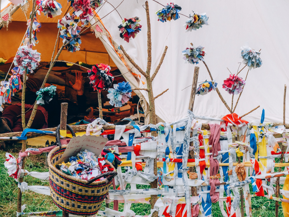 Photos of The Greencrafts Village, Glastonbury Festival 2015: Rags to Bitches,  fabric pompoms and rag head-dress, flower broach, collage and plastic bag flowers