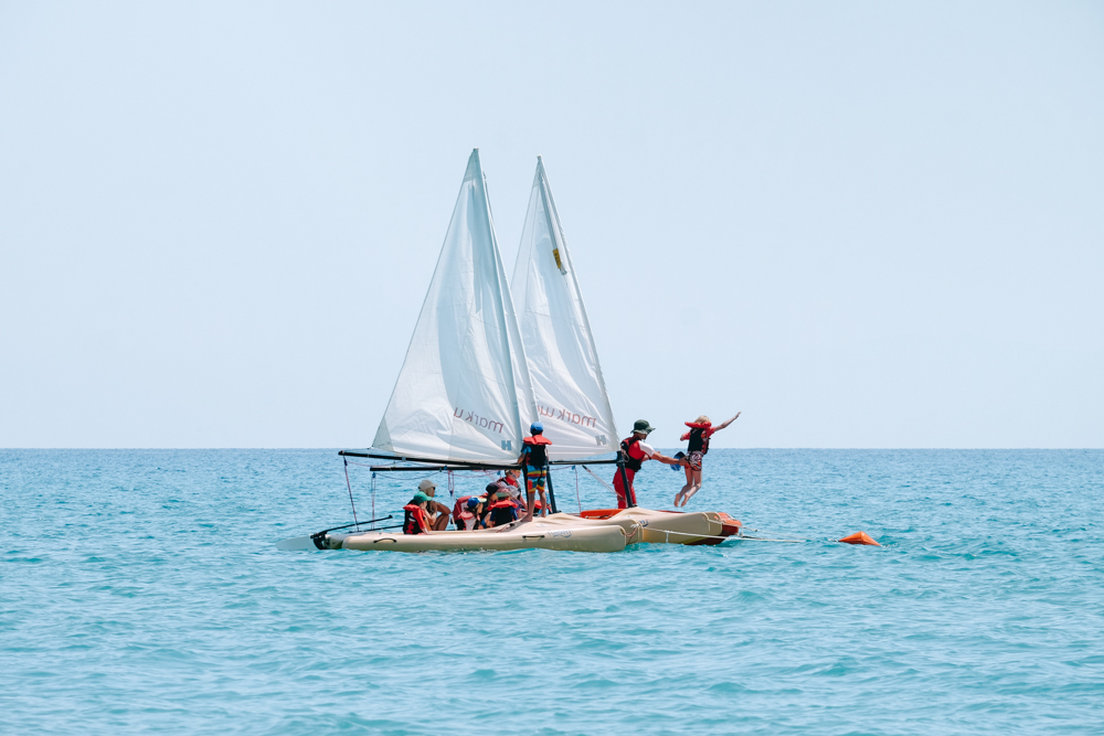 Jumping from the boat into the sea with kids Club sailing at Mark Warner Levante Resort