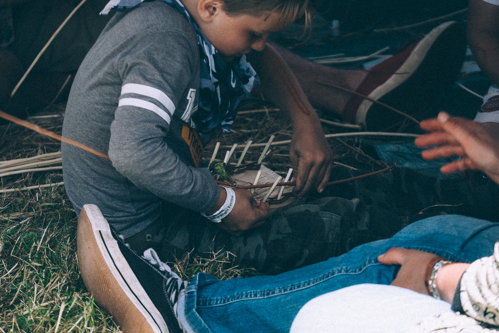 Boy making a willow boat