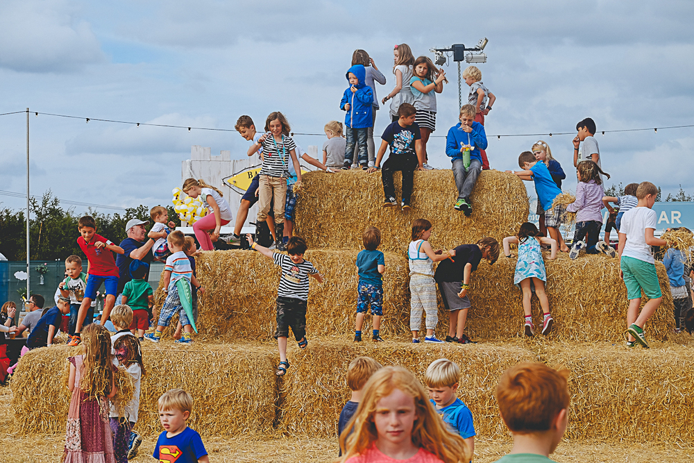 Children on hay bales at The Big Feastival 2015