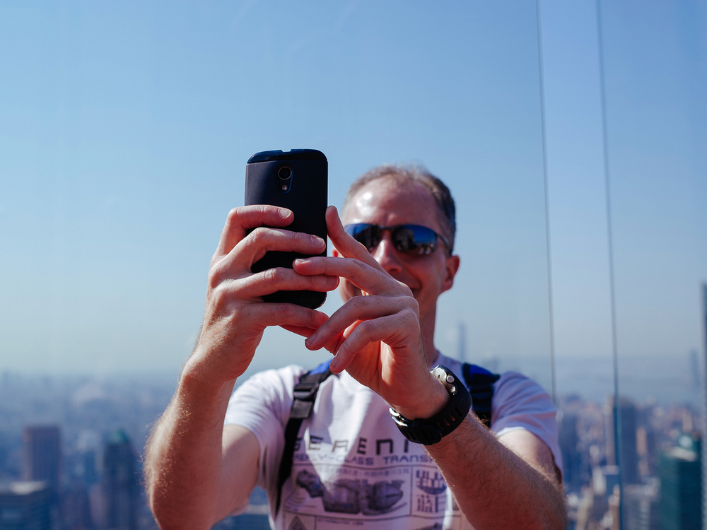 Man taking photo on mobile phone