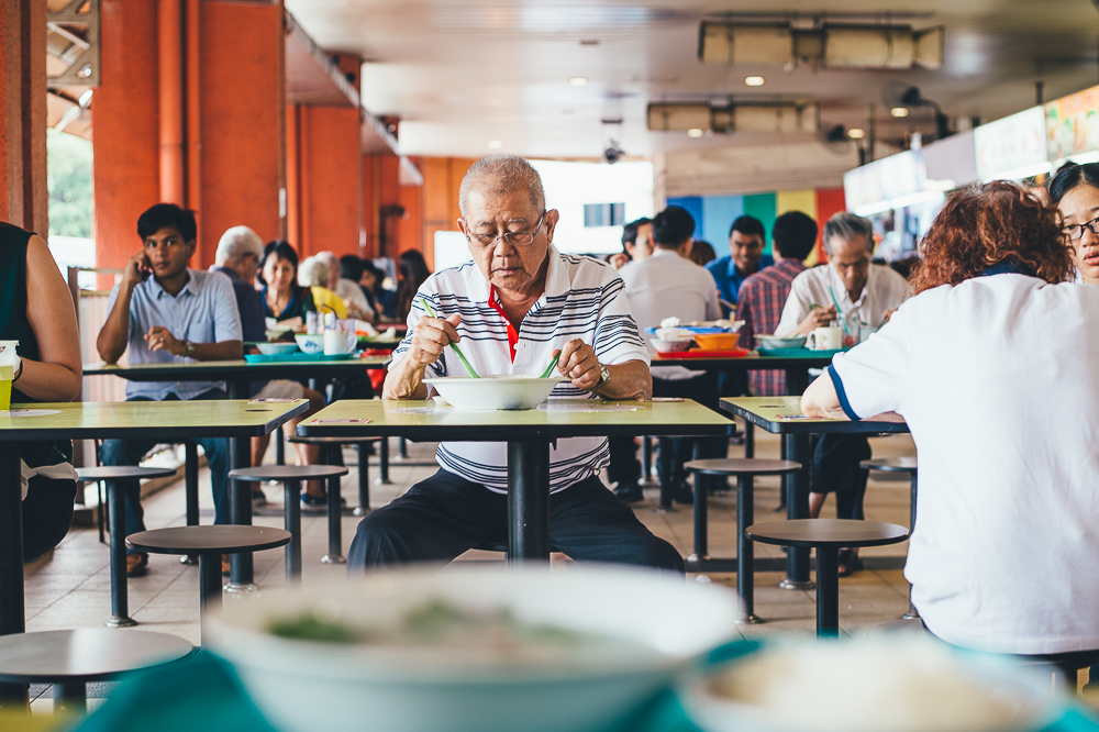 Man eating in Hawker Centre, Singapore