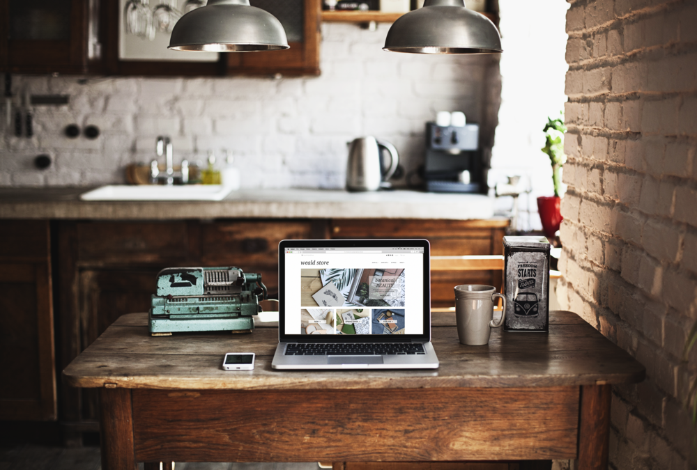 photo of a laptop macbook in a kitchen, on a kitchen table