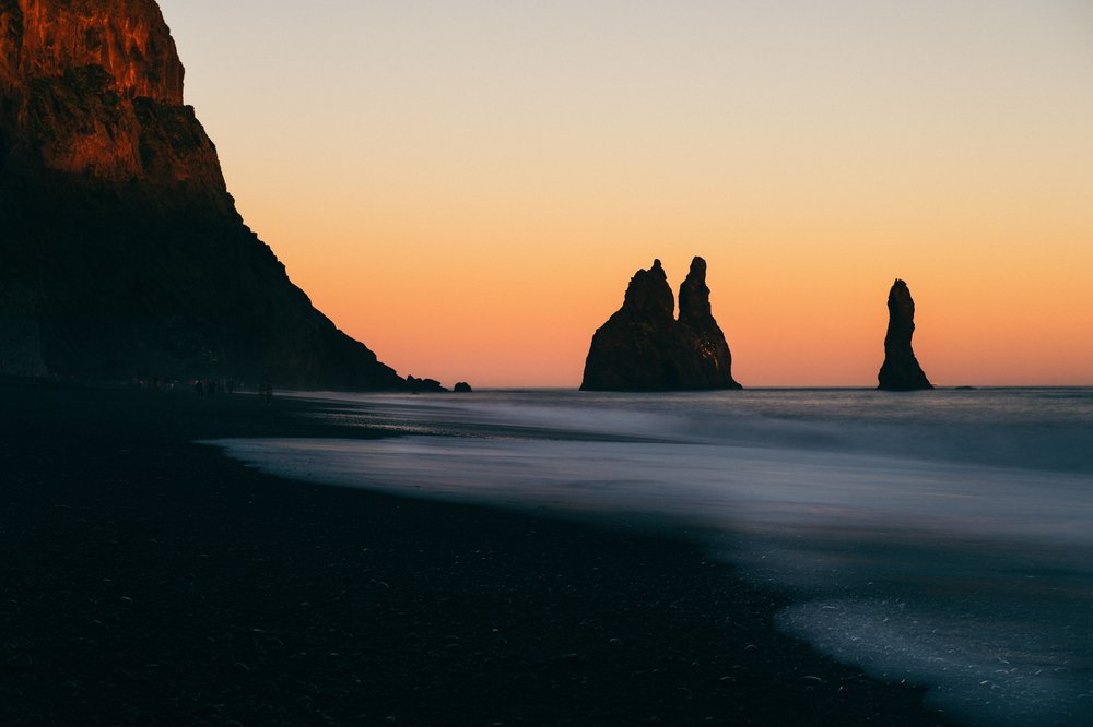 Reynisdrangar and the Black Sand Beach at Vik, Iceland - Photo by Sorasak via Unsplash