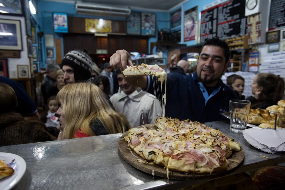 """""""Fugazza"""" with ham at El Cuartito - Buenos Aires"""