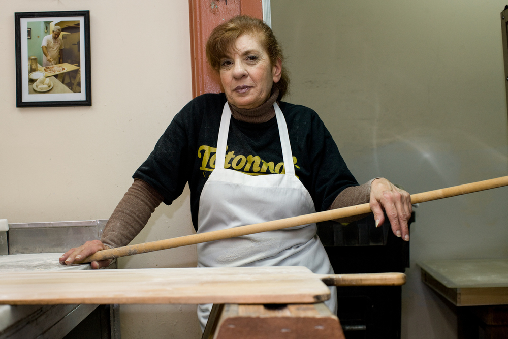 Cookie Ciminieri, co-owner of Totonno's. She's the one who runs the place, which was opened by her grandfather in 1924 and has had just 5 pizza makers total in the past 90+ years.
