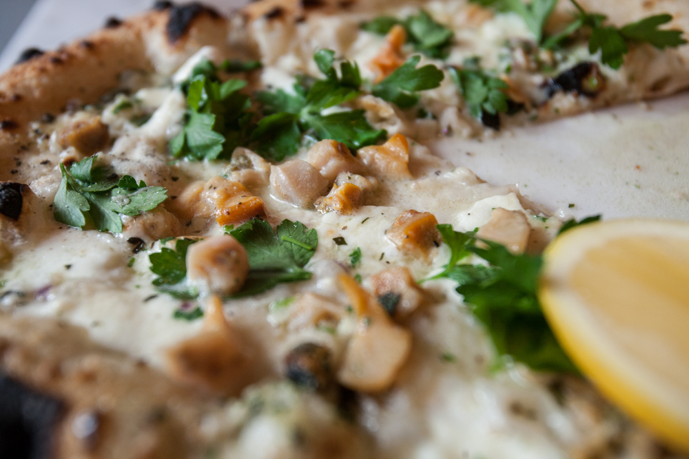Close-up of Motorino's clam pizza, where the clams are shucked to order just before baking.