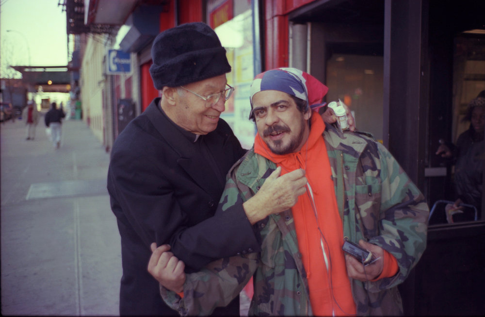 Father Jose Otero with parishioner William Jacobs, in East Harlem, Wednesday 11/17/99