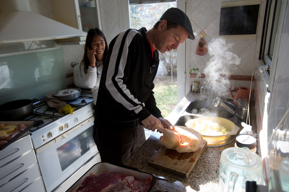 Man Prepares Chicken, Argentina
