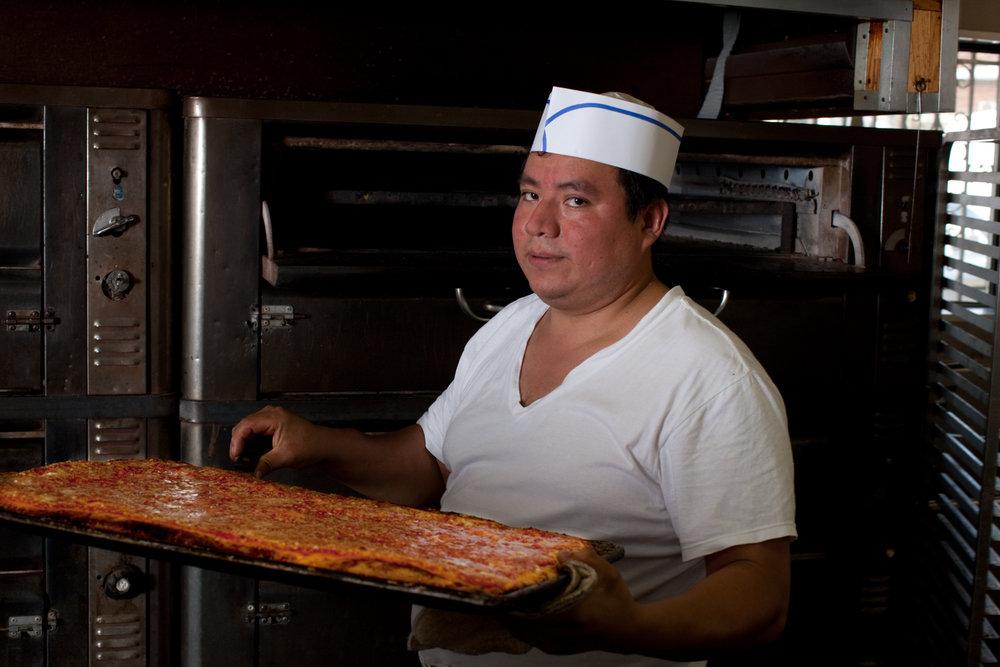 Pizza-maker at L&B Spumoni Gardens, in Gravesend.