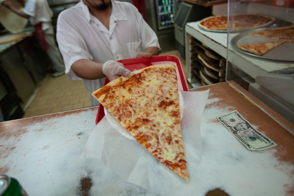 Large slice being served at Koronet Pizza, which is on Broadway near 110th Street.