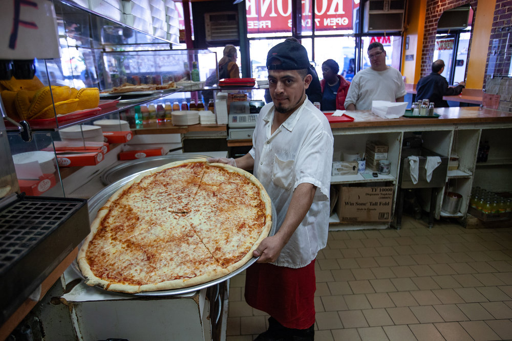 "Koronet's enormous pizzas (32"" in diameter) remain such a deal ($3.75, as of 2018), that perhaps the place'd be busy even with subpar pizza. But thankfully, these slices are good, too! Go for the novelty + value - and have a good lunch!"