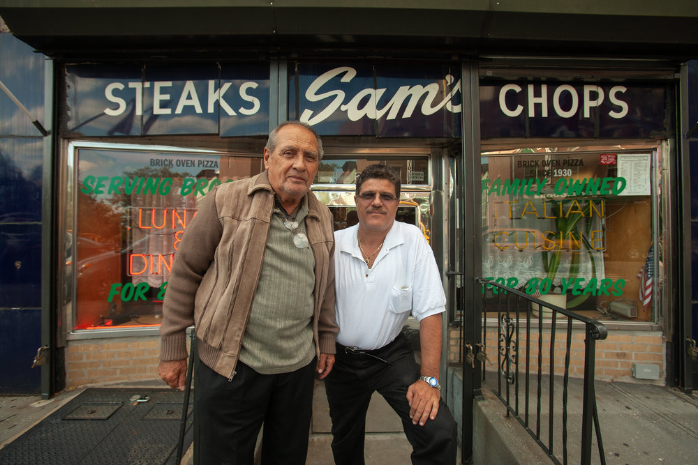 Louie and his now-deceased father Mario, in front of their Pizza and Italian restaurant Sam's, on Court Street in Brooklyn.