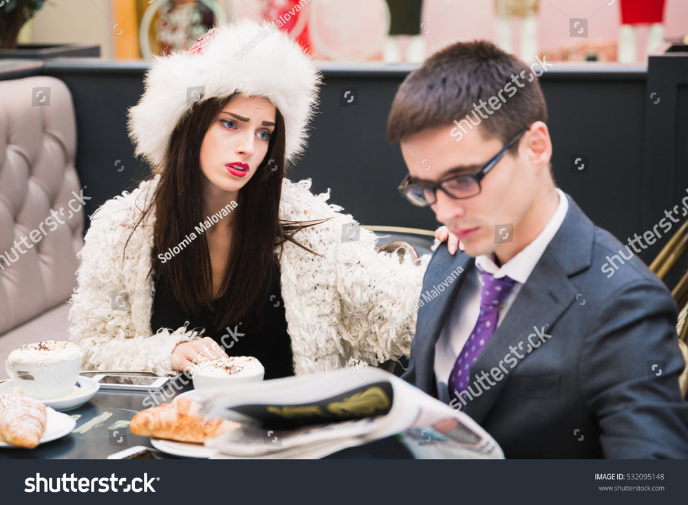 stock photo young kid who needs to look at the menu to order a drink.jpg