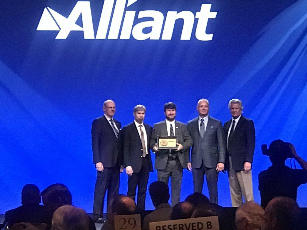 Caddell Construction receiving their Alliant Award