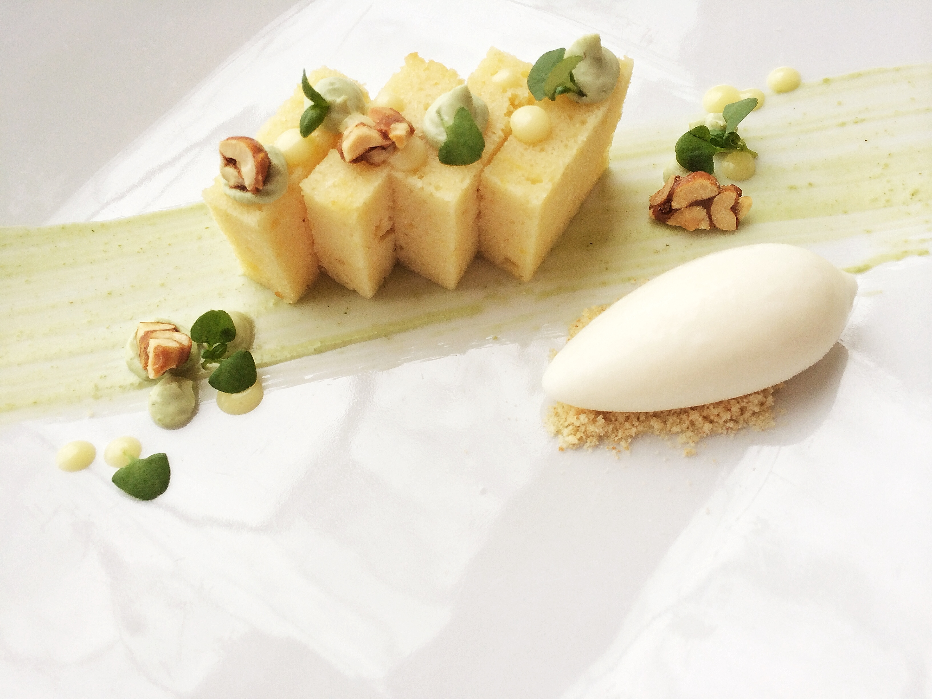 Lemon cake, lemon curd, basil yogurt, microbasil, honey-roasted nuts, and greek yogurt sorbet. Ready for Spring!