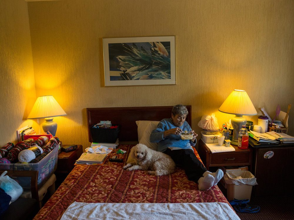 Rosemarie Patronella, 74, eats a lunch of ramen noodles and buttered rice in her room at a Ramada in Houston. Hunger among the elderly is particularly severe in Texas and has risen since 2007. Patronella is a retired schoolteacher who carefully stocks up on food from charities to ensure she has enough.