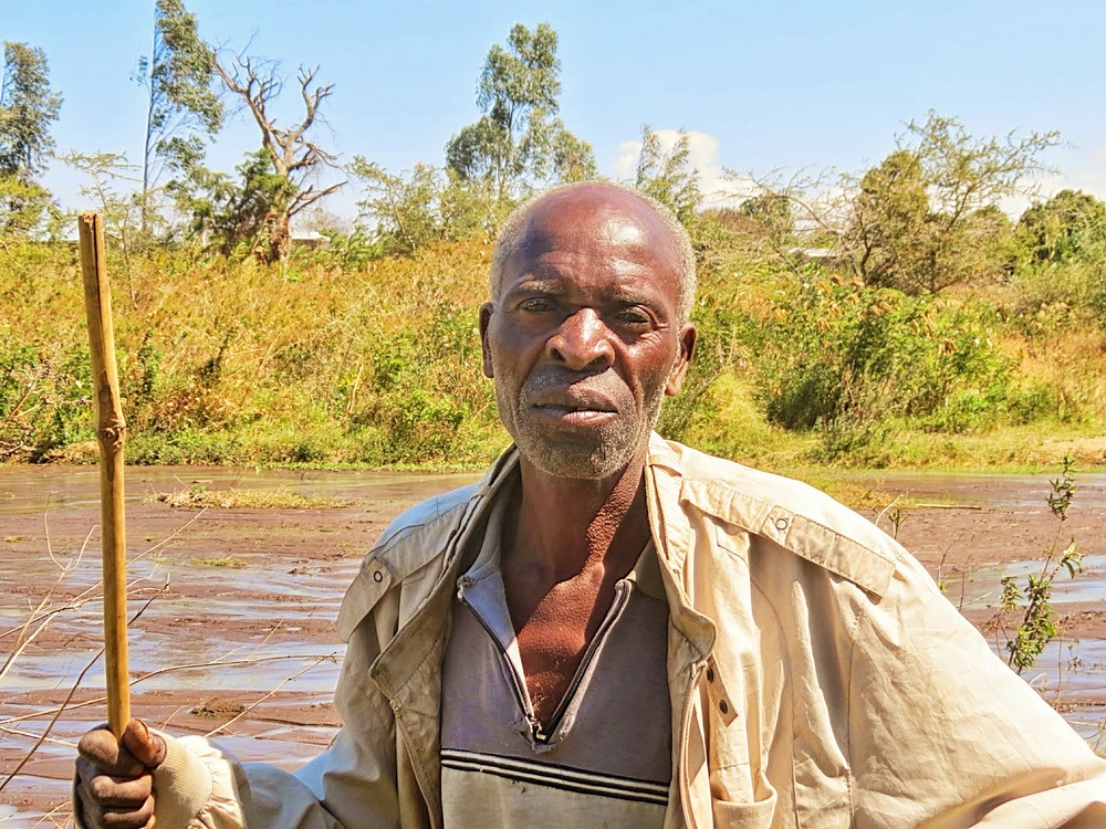 A farmer poses for a portrait in Tanzania. I flew to meet my boyfriend who had worked here for a few years teaching computer science.